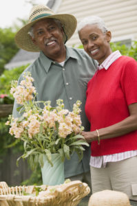 Couple arranging flowers